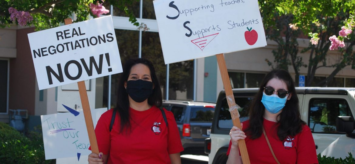 WEA members protest before a session of the Woodland School Board.